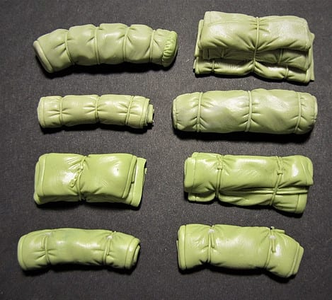 Green Stuff and Magic Sculp modelling putties mixed together to create military rolls