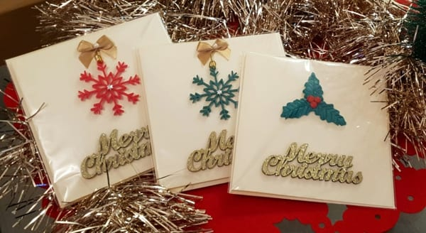 Handmade Christmas cards featuring tree decorations gifts made from casting resin